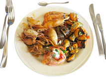 Raw Mixed seafood shrimps, octopus and mussels on dish Royalty Free Stock Photography