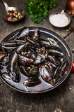 Raw mussels in water on dark wooden table, preparation for cooking Royalty Free Stock Photography