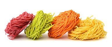 Raw noodle. Raw homemade pasta, isolated on white Stock Image