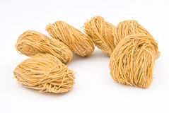 Raw noodles Stock Images