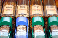 Raw Nut Varieties In Bulk Dispensers. An organic grocery store offers the bulk purchase of nut varieties including almonds and pecans royalty free stock photos