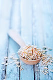 Raw oat flakes. In spoon and on a table Royalty Free Stock Photography