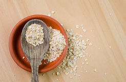 Raw oatmeal in a bowl Royalty Free Stock Photos