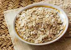 Raw oatmeal in a saucer Royalty Free Stock Images
