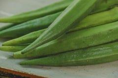 Raw okra. Farm fresh raw okra on wooden rustic table Royalty Free Stock Photography