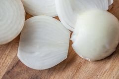 Raw Onion on cutting board. Raw white onion on a cutting board with rings that are clear Royalty Free Stock Photo