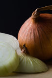 Raw Onions, Peeled, Unpeeled and Sliced Stock Image