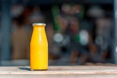 Raw orange juice in glass bottle Royalty Free Stock Photo