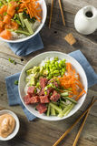 Raw Organic Ahi Tuna Poke Bowl. With Rice and Veggies Royalty Free Stock Photos