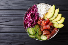 Raw Organic Ahi Tuna Poke Bowl with Rice and Veggies close-up. H royalty free stock images