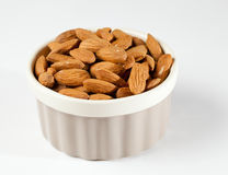 Raw organic almonds in bowl Royalty Free Stock Images