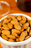 Raw organic almonds in bowl Royalty Free Stock Photos