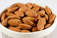 Raw organic almonds in bowl Royalty Free Stock Photo