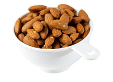 Raw organic almonds in measuring cup Stock Photo
