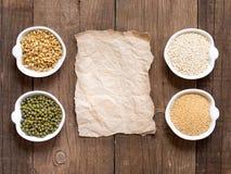 Raw Organic Amaranth and quinoa grains, wheat and mung beans Stock Photo