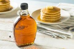 Raw Organic Amber Maple Syrup royalty free stock photo