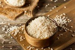 Raw Organic Arborio Rice. In a Bowl Stock Photos