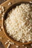 Raw Organic Arborio Rice. In a Bowl Stock Photo