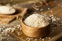 Raw Organic Arborio Rice. In a Bowl stock images