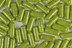 Raw Organic Barley Greens. Tope view of barley greens pill royalty free stock photo
