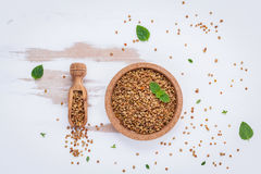 Raw organic bee pollen on shabby wooden board. Bee pollen granul. Es and propolis in wooden scoop. Homeopathic food concept with bee pollen with peppermint and Royalty Free Stock Image