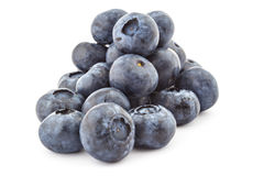 Raw organic blueberries. Pile of fresh ripe organic blueberries isolated on a white background Royalty Free Stock Photos
