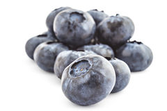 Raw organic blueberries. Pile of fresh ripe organic blueberries isolated on a white background Royalty Free Stock Image