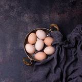 Raw Organic Brown Eggs in a copper bowl Royalty Free Stock Photos
