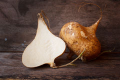 Raw Organic Brown Jicama or yam-bean. Stock Photos