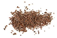 Raw organic cacao nibs. On a white background royalty free stock photography