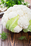 Raw organic cauliflower on wooden table. Raw organic cauliflower  on wooden table Royalty Free Stock Images