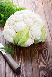 Raw organic cauliflower on wooden table. Raw organic cauliflower  on wooden table Royalty Free Stock Photography