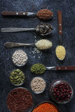 Raw organic cereal grains, seeds and beans in wooden spoons and bowls Stock Photo