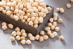 Raw organic chickpeas - Cicer arietinum. Chickpeas contain slow-absorbing carbohydrates and a large amount of fiber Royalty Free Stock Photos