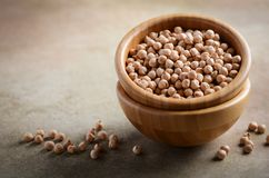 Raw organic chickpeas in a wooden bowl, healthy vegan vegetarian food ingredient. Stock Images