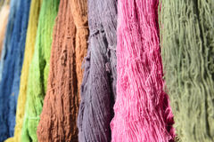 The raw organic cotton yarn in tray with the colorful thread. The yellow organic handmade cotton Stock Photography