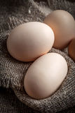Raw organic farm eggs. Raw organic farm eggs on the old background Stock Photos