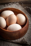 Raw organic farm eggs. Raw organic farm eggs on the old background Stock Image