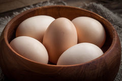 Raw organic farm eggs. Raw organic farm eggs on the old background Stock Images