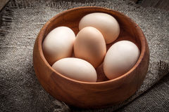 Raw organic farm eggs. Raw organic farm eggs on the old background Royalty Free Stock Photography