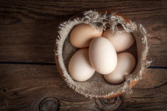 Raw organic farm eggs. Raw organic farm eggs on the old background. Top view Stock Image