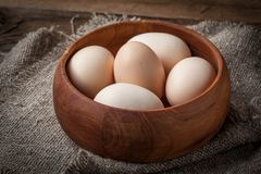 Raw organic farm eggs. Raw organic farm eggs on the old background Royalty Free Stock Photo