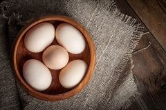 Raw organic farm eggs. Raw organic farm eggs on the old background. Top view Stock Images