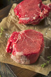 Raw Organic Grass Fed Filet Mignon Steak. With Salt and Herbs Stock Photos