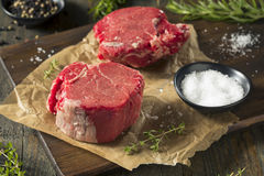 Raw Organic Grass Fed Filet Mignon Steak. With Salt and Herbs royalty free stock photos