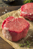 Raw Organic Grass Fed Filet Mignon Steak. With Salt and Herbs stock photography