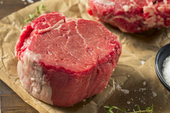 Raw Organic Grass Fed Filet Mignon Steak. With Salt and Herbs Stock Images