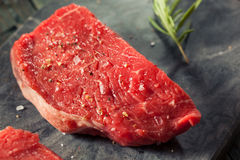 Raw Organic Grass Fed Sirloin Steak. With Salt and Pepper stock images