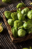 Raw Organic Green Baby Artichokes Stock Photography