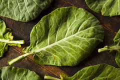 Raw Organic Green Collard Greens. On a Background stock image